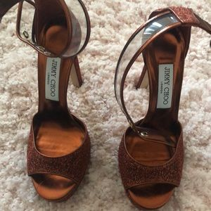 Rust colored ankle strap open toe Choo heels.